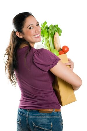 sac �picerie: Young woman holding a grocery bag full of fresh and healthy food isolated on white background