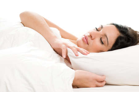 pillow sleep: Beautiful young woman sleeping on white isolated