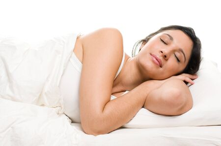 white blanket: Beautiful young woman sleeping on white isolated