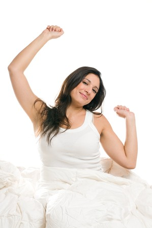Young woman stretching herself in the morning isolated on white background photo