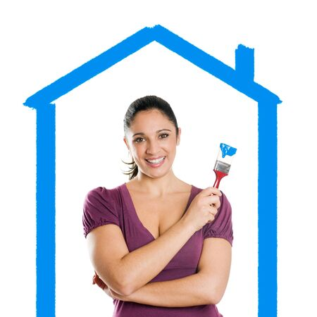 Young attractive woman with blue paintbrush dreaming her new house photo