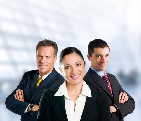 Multi aged happy business team with woman and men in a modern office with copy space photo