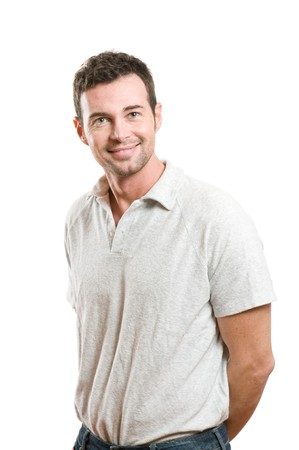 Smiling young casual man looking at camera with confidence, isolated on white background photo