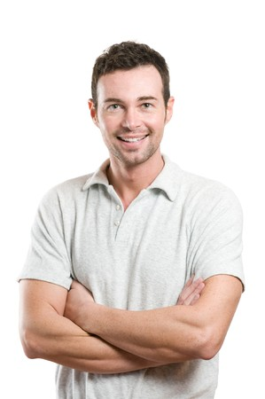 Smiling young casual man looking at camera with joy and confidence, isolated on white background photo