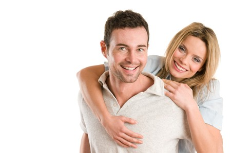 copy sapce: Young smiling man piggyback his beautiful girlfriend isolated on white background with copy sapce Stock Photo