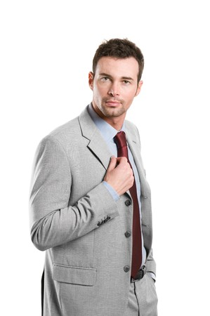 Professional young businessman looking at camera with confidence isolated on white background photo