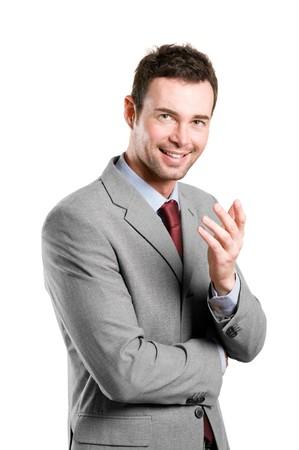 Smiling young natural businessman explaining isolated on white background photo