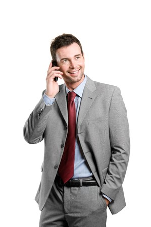 businessman talking: Young smiling businessman talking on mobile isolated on white background Stock Photo