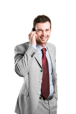Young smiling businessman talking on mobile isolated on white background photo