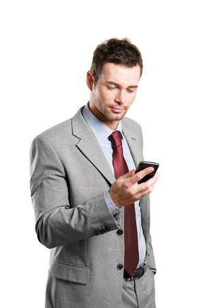business man phone: Young businessman looking at his pda mobile phone isolated on white background
