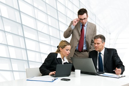 Group of business people analyzing and discussing during a working meeting in a modern office photo