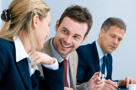 Business team smiling and talking together during a working meeting in office Stock Photo - 8235681