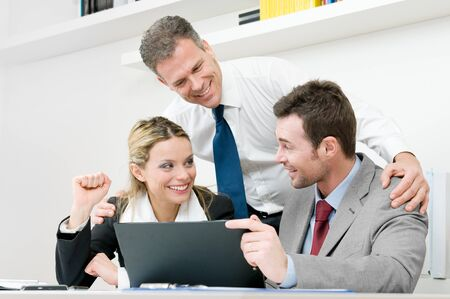 Happy business team celebrate and working together during a meeting in office photo