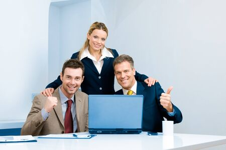 Happy successful bussiness team celebrate in their modern office photo