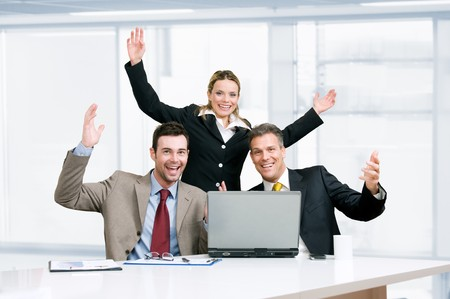 Happy smiling business team celebrate their new success in their modern office Stock Photo - 8235675