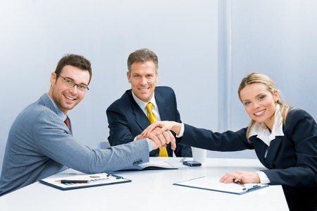 teamwork together: Happy smiling business team holding hands in a heap, good teamwork work Stock Photo