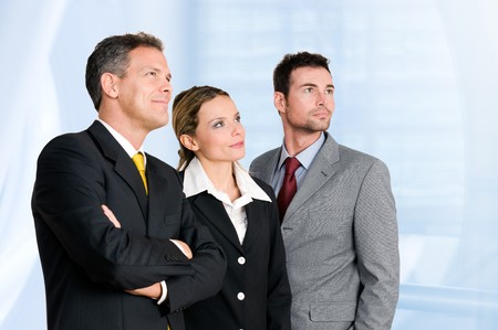 Smiling confident business team looking away at their bright future photo