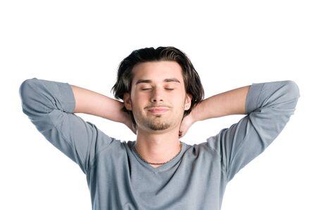 closed eyes: Jonge Latijns-man het nemen van een pauze en ontspannen met gesloten ogen geïsoleerd op witte achtergrond