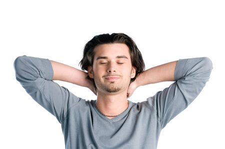 hands behind head: Young latin man taking a break and relaxing with closed eyes isolated on white background Stock Photo