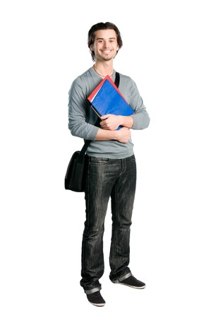 college student: Happy young student standing full length with books and notes isolated on white background Stock Photo