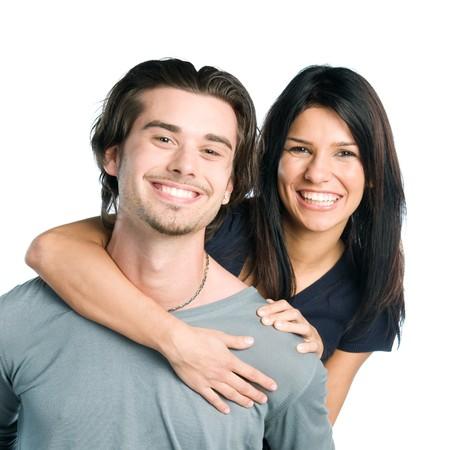 latin couple: Happy smiling young latin couple piggyback isolated on white background