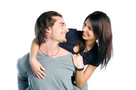 looking at each other: Happy young couple looking each other while piggyback with fun, isolated on white background Stock Photo