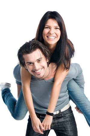 háton: Happy young latin couple smiling and playing piggyback isolated on white background