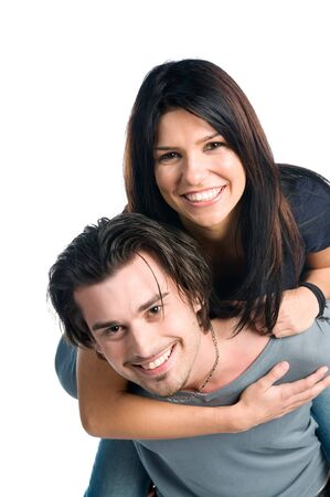 Happy young latin couple smiling and playing piggyback isolated on white background photo