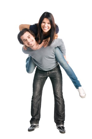 Young happy latin couple playing together piggyback isolated on white background photo