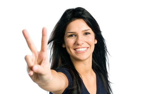 Young latin teenager girl showing victory sign isolated on white background Stock Photo - 8235687