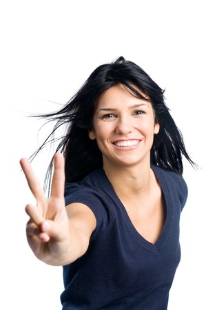 victory: Happy young latin teenager girl showing victory sign isolated on white background Stock Photo