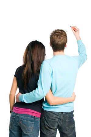 Rear view of young couple writing on blank white board. Compile with your text! Stock Photo - 8235772