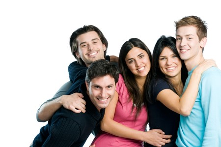 friend hug: Happy smiling group of young friends standing and embracing together isolated on white background with copy space