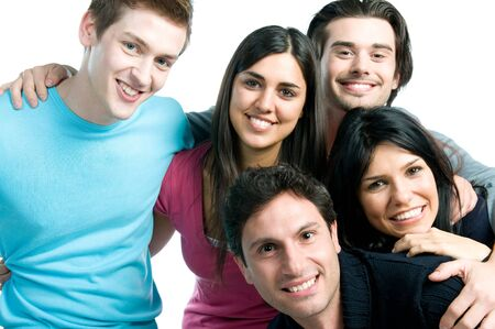 Close up of young group of smiling friends isolated on white background Stock Photo - 8236172