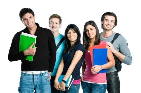 estudiantes universitarios: Grupo de estudiantes de adolescente feliz de pie y sonriente con libros y bolsas aisladas sobre fondo blanco.  Foto de archivo