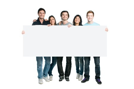 holding blank sign: Happy young group of people standing together and holding a blank sign for your text, isolated on white background