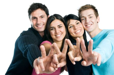 Happy smiling group of friends showing victory signs isolated on white background photo