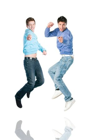 two fingers: Two young happy jumping men pointing at you with index finger Stock Photo