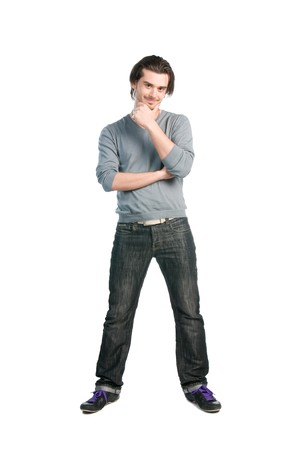 Happy thinking young man with positive expression standing full length isolated on white background photo