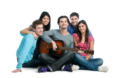 Happy young group of friends have fun and playing together the guitar isolated on white background photo