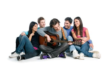 sing: Happy young group of friends have fun and playing together the guitar isolated on white background