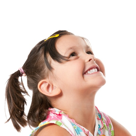 Smiling little child looking up at copyspace isolated on white background photo