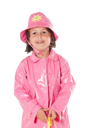 waterproof cape: Happy smiling little girl with pink raincoat isolated on white background