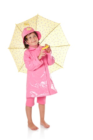 waterproof cape: Happy little girl with raincoat and umbrella isolated on white background Stock Photo