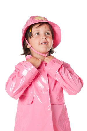 raincoat: Happy little girl with pink raincoat isolated on white background