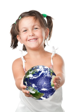 serene people: Happy smiling little girl holding and offering planet heart, symbol of environmental conservation and green attitude Stock Photo