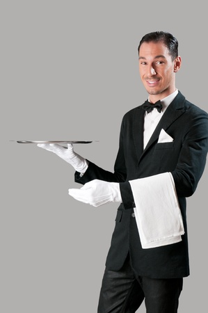 Professional waiter serving with empty stainless tray, perfect for your product photo