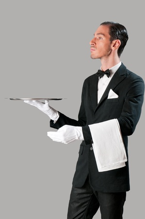 Haughty waiter holding an empty tray to place your product photo
