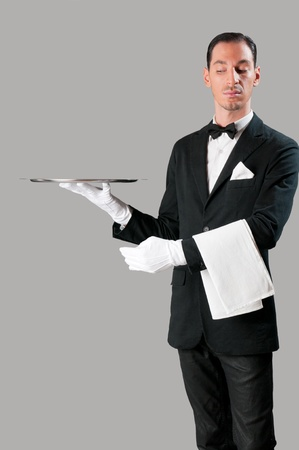 servings: Haughty waiter holding an empty tray to place your product