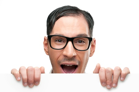 stupor: Surprised and shocked happy nerd holding white placard isolated on white background Stock Photo